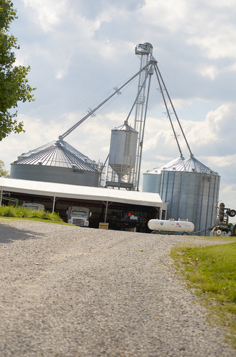 large grain silos with a truck beneath